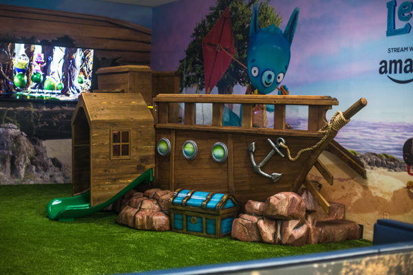 Kids play zone at JFK Airport with Amazon Prime's Tumbleaf show theme.
